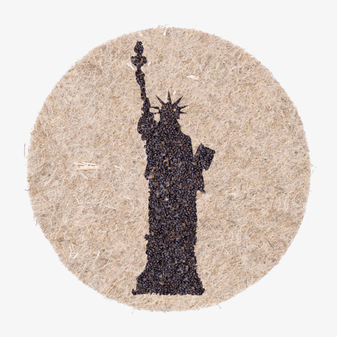 united states statue of liberty with plant seeds to grow